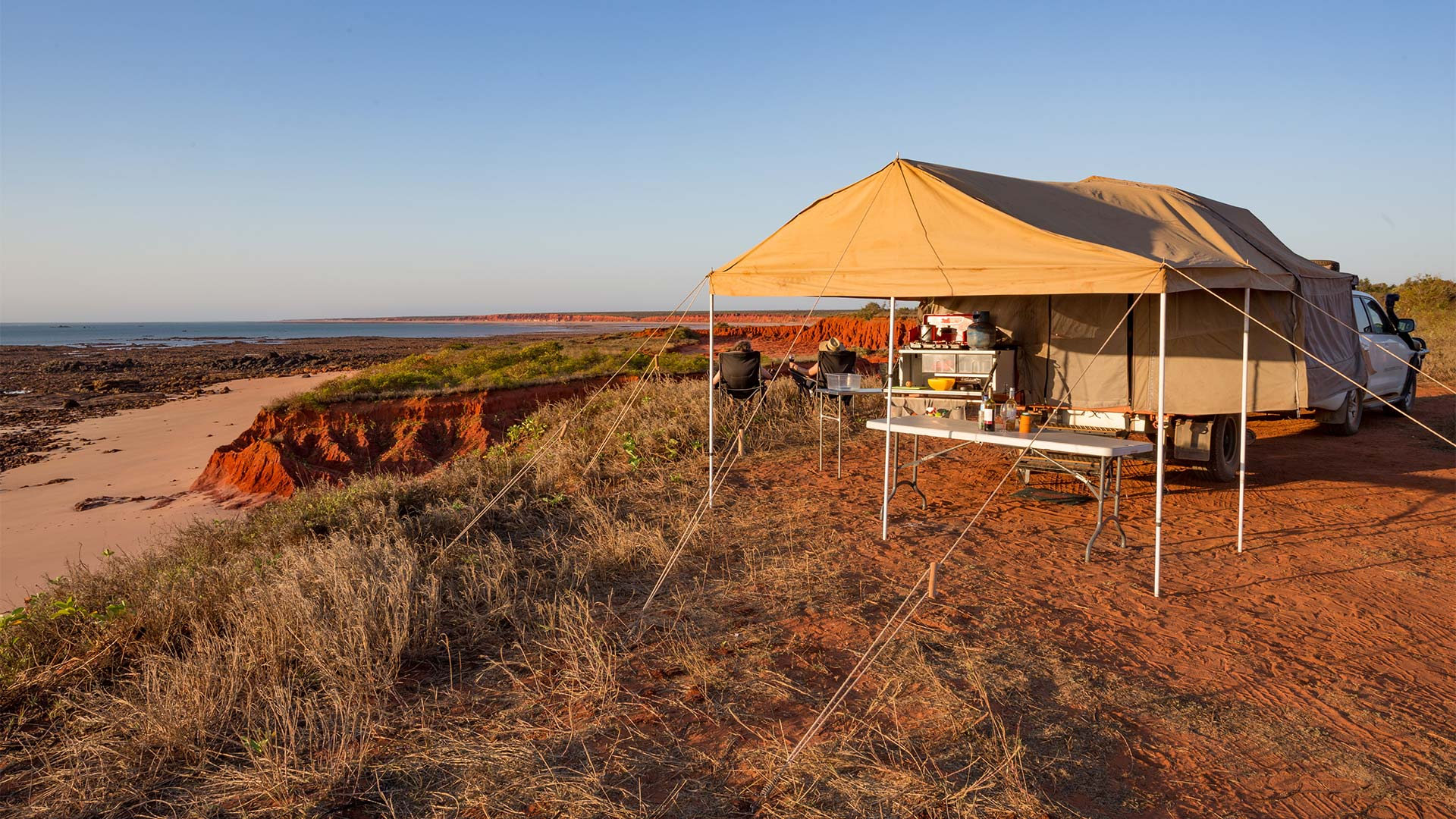 A couple camped on the Australian coast with a four wheel drive